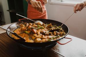 Eat with locals: Traditional paella & tortilla & sangría