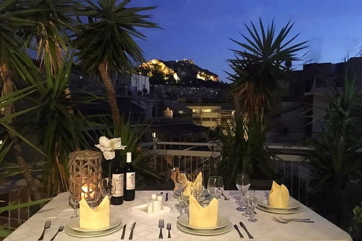 Greek traditional dinner with a view of lycabetus hill