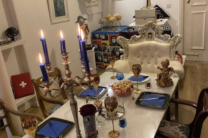 Eclectic cheese fondue dinner party in flamboyant setting