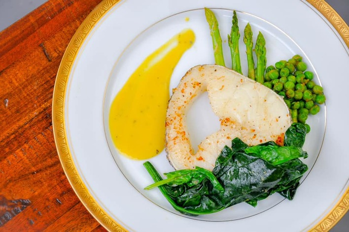 Gourmet preparation- pan fried cod served with mango sauce and stewed ...